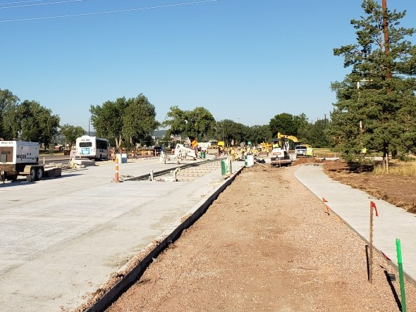 Omaha Street Reconstruction, west end of Phase 1, driving lane tie-ins and installation of street lighting conduit. 2020-09-03