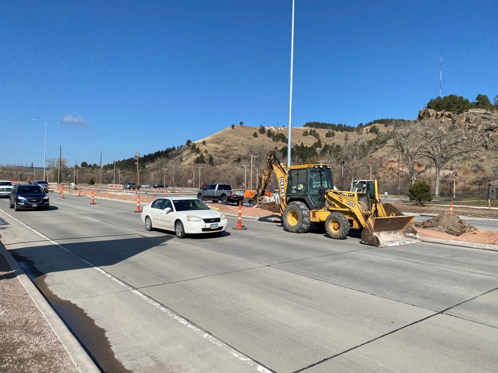 Excavation work on the median in preparation to install decorative concrete. March 24, 2021 (John Van Beek/Ferber Engineering Company)