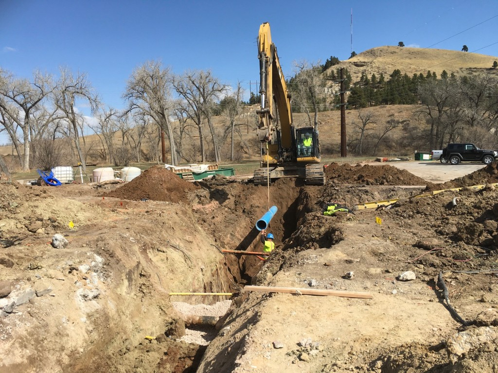 Crews install water main on the north side of Omaha Street near the intersection of Mountain View Road in Rapid City, South Dakota, Wednesday, March 31, 2021